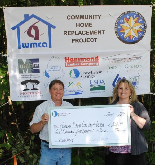 Skwohegan team presenting a check to WMCA Home Replacement Program